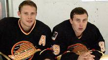 Hockey fans flock to a new arena to see the dynamic duo of Pavel Bure (left) and Alexander Mogilny (right), but the Vancouver Canucks have a few problems to solve before being considered NHL championship contenders.