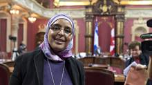 Samira Laouni leaves after she appeared before a legislature committee studying the proposed Quebec Charter of Values at the National Assembly in Quebec City on Jan. 14, 2014. (JACQUES BOISSINOT/THE CANADIAN PRESS)