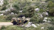 Syrian armoured personnel carriers are seen at the Wadi Khalid area near the Syrian border in northern Lebanon April 12, 2012. (Jamal Saidi/Reuters/Jamal Saidi/Reuters)