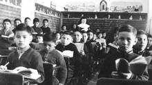 Children sit in a classroom at St. Joseph's Residential School in Cross Lake, Man., in 1951. Some lawyers say that former students of the schools often do not pursue compensation claims that were unfairly denied because they are intimidated by the complicated legal process.