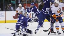 Toronto Maple Leafs goalie Garret Sparks makes a save as Nazem Kadri and New York Islanders' Ryan Strome battle for position at Air Canada Centre on March 9. (John E. Sokolowski/USA Today Sports)