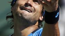 David Ferrer of Spain serves to Kevin Anderson of South Africa during their match at the BNP Paribas Open ATP tennis tournament in Indian Wells, California, March 9, 2013. Ferrer lost 3-6 6-4 6-3. (DANNY MOLOSHOK/REUTERS)