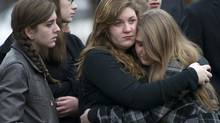 Mourners are seen outside the funeral for Noah Pozner, 6, in Fairfield, Conn., Dec.17, 2012. Noah was one of 20 children killed in the Sandy Hook school shooting. (Kevin Van Paassen/The Globe and Mail)