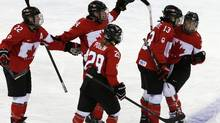 Canada's Meghan Agosta-Marciano, right, celebrates her goal against Finland with teammates, from left to right, Hayley Wickenheiser (22), Natalie Spooner (24), Marie-Philip Poulin (29) and Caroline Ouellette (13), during the third of their women's ice hockey game at the 2014 Sochi Winter Olympics, February 10, 2014. (GRIGORY DUKOR/REUTERS)
