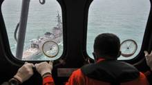 A Malaysian Navy ship is seen from an Indonesian Air Force Super Puma helicopter during a search mission for for AirAsia flight QZ8501 off the coast of Central Kalimantan January 6, 2015. (Veri Sanovri/Pool/REUTERS)