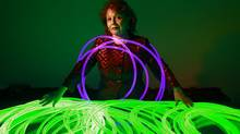Betty Lou Pacey, owner of Innovative Lighting, is surrounded by large core of optical fibre lighting in her offices in Vancouver. (JEFF VINNICK/THE GLOBE AND MAIL)