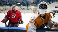 Goalies Christopher Bassels (right) and Andy Schonberger walk off the ice after playing opposing sides of a pick-up hockey game at the Upper Canada College in Toronto on Thursday, February 2, 2017. (Christopher Katsarov/The Globe and Mail)