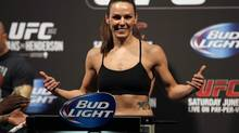 Bantamweight Alexis Davis makes weight during the UFC 161 weigh-in in Winnipeg, Man. on Friday June 14, 2013. (John Woods/THE CANADIAN PRESS)