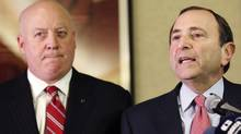 NHL Commissioner Gary Bettman, right, and deputy commissioner Bill Daly speak to reporters, Thursday, Dec. 6, 2012, in New York. (Associated Press)