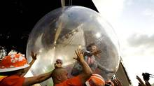 Wayne Coyne, lead singer of the Flaming Lips, rolls over the audience in a plastic bubble on July 26, 2008, at the Pemberton Festival in Pemberton, B.C. (Jennifer Roberts/The Globe and Mail)