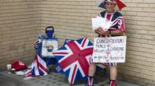Royal supporter Terry Hutt with his royal paraphernalia and a congratulatory placard outside St. Mary's Hospital in London on Friday, July 12, 2013. Cameras from all over the world are set to be jostling outside for an exclusive first glimpse of Britain's Prince William and the Duchess of Cambridge's first child. (Matt Dunham/AP)