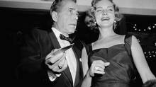 This Oct. 12, 1955 file photo shows actors Humphrey Bogart, left, and his wife, Lauren Bacall at the premiere of 'The Desperate Hours,' in Los Angeles. (Harold Filan/AP)