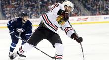 Chicago Blackhawks left wing Andrew Ladd (16) gets a shot off during the first period against the Winnipeg Jets at MTS Centre. (Bruce Fedyck/USA Today Sports)