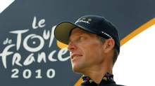 FILE - In this July 25, 2010, file photo, Lance Armstrong looks back on the podium after the 20th and last stage of the Tour de France cycling race in Paris, France. (Bas Czerwinski/AP)