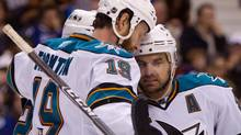 San Jose Sharks' Joe Thornton, 19, Patrick Marleau, back left, and Dan Boyle, right, celebrate Marleau's goal against the Vancouver Canucks during the second period of game 1 of the NHL Western Conference final Stanley Cup playoff hockey series in Vancouver, B.C., on Sunday May 15, 2011. THE CANADIAN PRESS/Darryl Dyck (Darryl Dyck/CP)