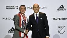 Jack Harrison shakes hands with commissioner Don Garber after being selected number one overall by the Chicago Fire during the 2016 MLS SuperDraft at Baltimore Convention Center. (Tommy Gilligan/USA Today Sports)