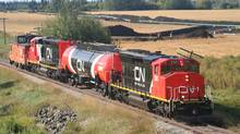 The photo was taken in northern Alberta. The photo depicts two locomotives paired with a tank car fuel tender. The caboose at the end of the train is not used in regular freight service with the locomotives. (CN)