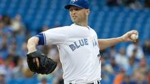 Toronto Blue Jays starting pitcher J.A. Happ (48) throws a pitch during the first inning in a game against the Baltimore Orioles at Rogers Centre, August 7, 2014. (Nick Turchiaro/USA Today Sports)