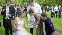 Blood and spit from Linda Geddes, seated, Nic Fleming, left, and 11 of their guests was tested for homone levels before and after the vows. (Nicola Jones for The Globe and Mail)