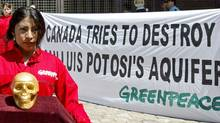 Greenpeace activists protest against mining operations outside the Canadian embassy in Mexico City on May 23, 2006. (SUSANA GONZALEZ/AFP/Getty Images)