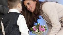 Britain's Catherine, Duchess of Cambridge is presented with a bouquet of flowers by Jamie Andrew, age seven, during a visit to the City Hospital in Peterborough in central England November 28, 2012. (Reuters)
