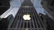 The leaf on the Apple symbol is tinted green at the Apple flagship store on 5th Avenue in New York, in this file picture taken on April 22, 2014. (BRENDAN MCDERMID/REUTERS)