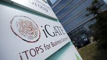 Signage is seen outside the offices of iGate in Mississauga. (Kevin Van Paassen/The Globe and Mail)