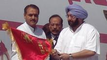 Indian Aviation Minister Praful Patel, left, and Punjab Chief Minister Amrinder Singh mark Air India's resumption of flights from Amritsar to Toronto, at the Rajasansi International Airport in Amritsar, on May 15, 2005. (AP/AP)