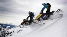 Mark Shaede and Quintin Raasch ride their snowmobiles near Revelstoke, B.C. in 2010, where two snowmobilers at a back-country competition were killed and 30 people were injured in an avalanche on Boulder Mountain. (JOHN LEHMANN/THE GLOBE AND MAIL)