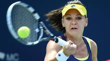 Agnieszka Radwanska of Poland returns to Venus Williams of the United States during the final of the Rogers Cup tennis tournament on Sunday August 10, 2014 in Montreal. (Paul Chiasson/THE CANADIAN PRESS)