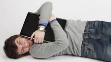 Man hugging a computer. (RAZVAN IONUT GRAUR/Getty Images/iStockphoto)