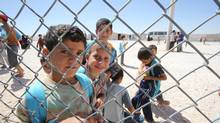 """Young Syrians on the first day of school this week at Zaatari refugee camp in Jordan: 'The behaviour of the students is very aggressive,' their principal says. 'They hit each other for no reason. They destroy their school materials."""" (Salah Malkawi for The Globe and Mail)"""