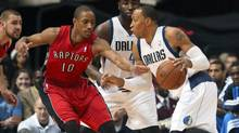 Dallas Mavericks small forward Shawn Marion (0) drives around Toronto Raptors shooting guard DeMar DeRozan (10) during the first quarter at American Airlines Center. (KEVIN JAIRAJ/USA TODAY SPORTS)