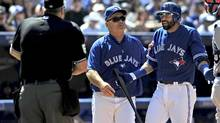 Toronto Blue Jays manager John Gibbons moves in between umpire Bill Welke and right fielder Jose Bautista after Bautista was tossed for arguing a strike three call in the sixth inning of the Jays 2-1 loss to the Tampa Bay Rays at Rogers Centre. (Dan Hamilton/USA TODAY Sports)