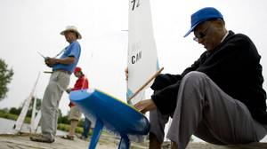 Ashley Marshall, 74, at right, has been sailing model boats since he was seven years old, in Grenada. At left, in blue, is Victor Wong, who also sails real Lazers and Fusion 15 sailboats.