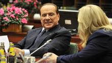 Italian Prime Minister Silvio Berlusconi speaks during the meeting of Heads of State or Government of the Euro area as part of an European Council at the Justus Lipsius building, EU headquarters in Brussels on Sunday. (GEORGES GOBET/AFP/GETY IMAGES/AFP/Getty Images)