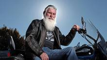 Tony O'Connell sits on his motorcycle at his home October 12, 2013 in Ottawa. He piloted the first ship through the Northwest Passage, Canada's Arctic waters. (Dave Chan for the globe and mail)