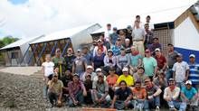 Karl Seger, third from right in front row, and a group of volunteers recently completed a school for 195 students in Nicaragua.