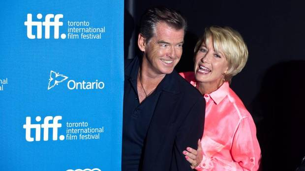 "Actress Emma Thompson pushes co-star Pierce Brosnan back out in front of photographers at a photo call for ""The Love Punch"" at the 2013 Toronto International Film Festival in Toronto on Thursday, Sept. 12, 2013. (Galit Rodan/THE CANADIAN PRESS)"