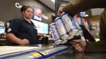 The Mac's store in Thamesford, Ont. is one of the few convenience stores in Ontario allowed to sell alcohol. There's a cold room for beer and an adjacent space where wine and had liquors are available. (Fred Lum/The Globe and Mail)