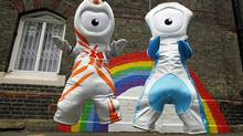 The 2012 Olympic mascots, Wenlock and Mandeville, make their debut in the playground at St. Paul's primary school in London on May 19, 2010.