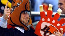 A B.C. Lions' fan cheers. (CP PHOTO/Jeff McIntosh) (Jeff McIntosh)