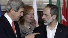 U.S. Secretary of State John Kerry, left, talks to Syrian opposition coalition leader Mouaz al-Khatib, during an international conference on Syria at Villa Madama, Rome, Feb. 28, 2013. The United States is looking for more tangible ways to support Syria's rebels and bolster a fledgling political movement that is struggling to deliver basic services after nearly two years of civil war, Kerry said Wednesday. (Riccardo De Luca/AP)