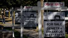 For sale signs are seen outside homes for sale in the Kitsilano neighborhood in Vancouver, B.C., in this file photo. (DARRYL DYCK For The Globe and Mail)
