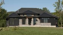 The Adelaide, whose model opens Oct. 29, is a bungalow that incorporates many rustic elements, 'only it's got that modern twist.'
