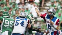 Montreal Alouettes quarterback Josh Neiswander looks to make a pass during first half CFL action against the Saskatchewan Roughriders in Regina on Saturday, Aug. 17, 2013. (Liam Richards/THE CANADIAN PRESS)