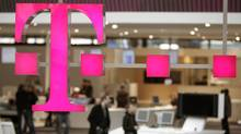 File photo of the sign of Deutsche Telekom AG is pictured at its stand for the upcoming CeBIT fair inside a hall in Hanover March 1, 2009. (HANNIBAL HANSCHKE/HANNIBAL HANSCHKE/Reuters)
