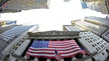 A large American flag draped across the front of the New York Stock Exchange Aug. 5, 2011. (STAN HONDA/2011 AFP)