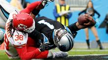 Cam Newton of the Carolina Panthers reaches across the goal line against Ron Parker of the Kansas City Chiefs for a touchdown during their game on Nov. 13, 2016. (Streeter Lecka/Getty Images)