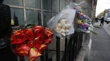 Flower tributes to late nurse Jacintha Saldanha are seen outside the residential apartments of the the King Edward VII Hospital where she was found dead, in central London, Monday. (Lefteris Pitarakis/AP)